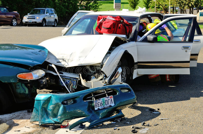 Extrication. Fire fighters and paramedic emt personnel extricate the victim of a two vehicle head on accident at an intersection in Roseburg, OR on August 27 royalty free stock photos
