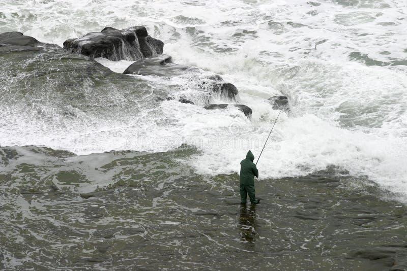 extrordinaire捕鱼海浪 库存图片