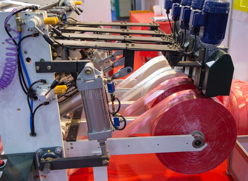 Prodution of plastic bag, Extruder. Extruder of polyethylene for industry process of plastic bag stock photo