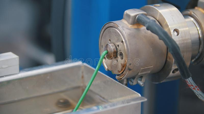 Extrusion manufacturing line - extruder, close up. View stock image