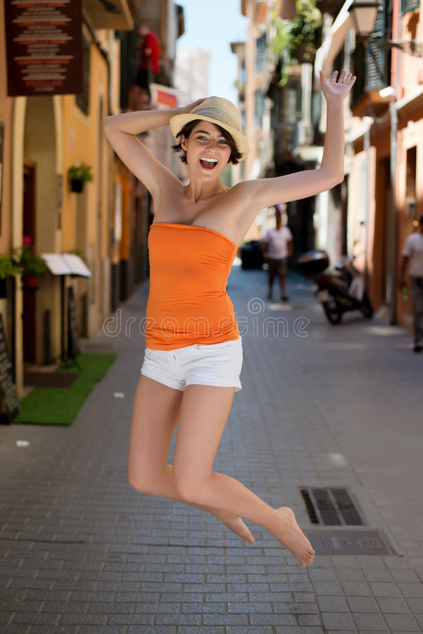 Download Exuberant Young Woman Jumping For Joy Royalty Free Stock Photos - Image: 32083018