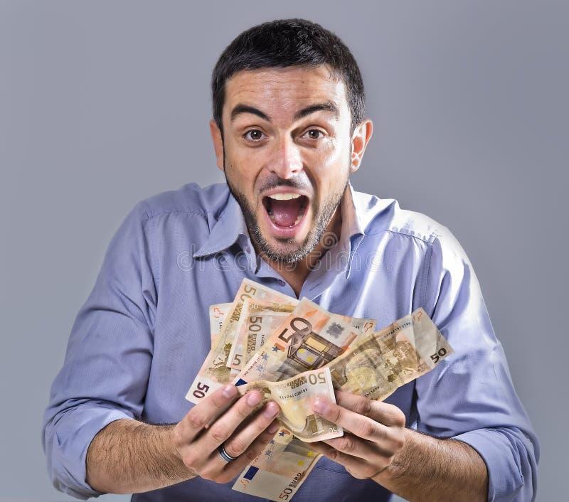 Exultant Bankbiljetten van de Jonge Mensenholding stock foto