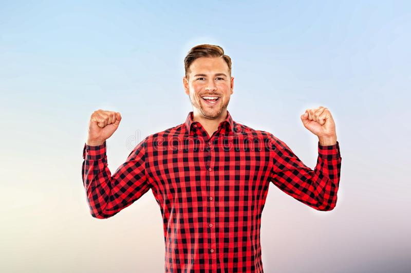 Exultant man cheering a personal success stock images