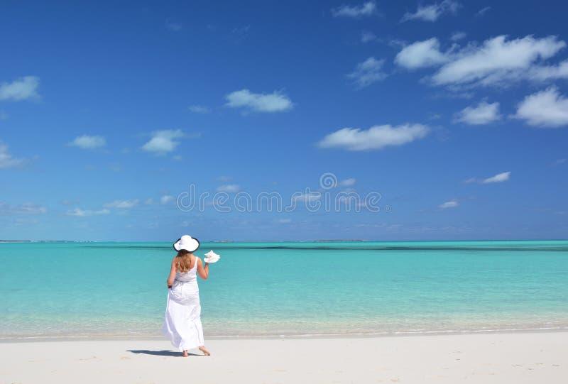 Exuma, Bahamas. Girl on the desrt beach. Exuma, Bahamas stock photo
