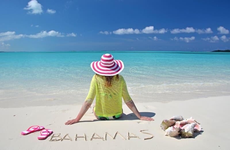 Exuma, Bahamas. Girl relaxing on the beach of Exuma, Bahamas royalty free stock photo