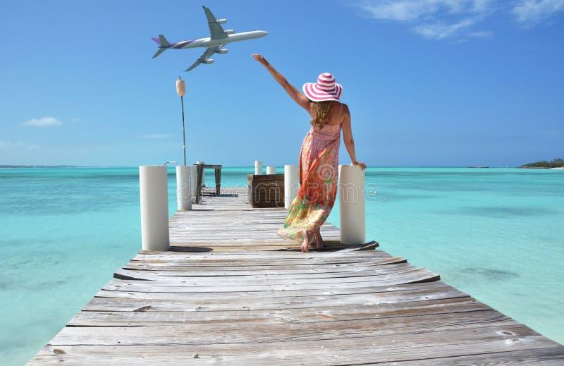 Exuma, Bahamas. Girl on the wooden jetty. Exuma, Bahamas stock photography