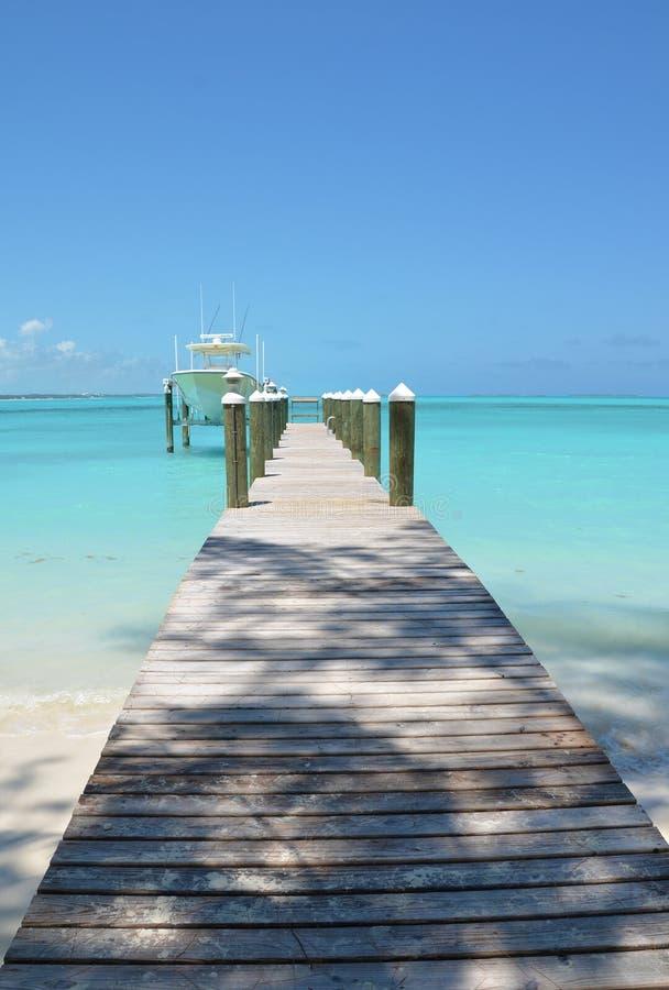 Exuma, Bahamas. Wooden pier and yacht. Exuma, Bahamas royalty free stock image