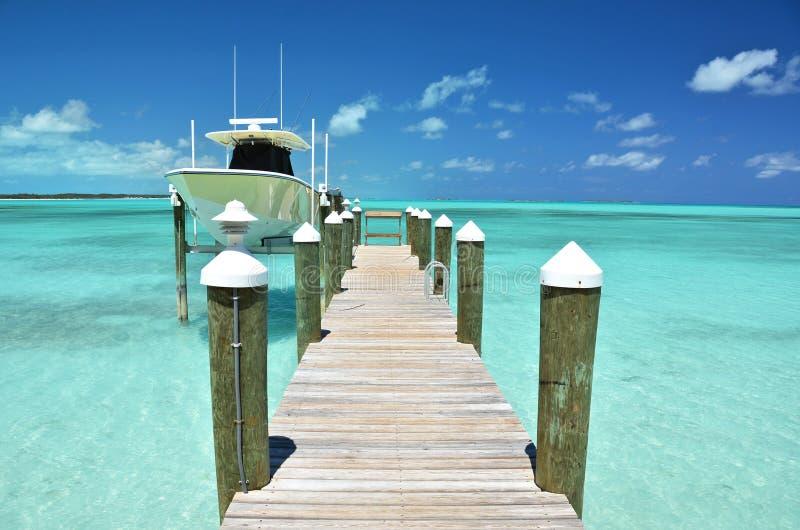 Exuma, Bahamas. Yacht at the wooden jetty. Exuma, Bahamas royalty free stock photos