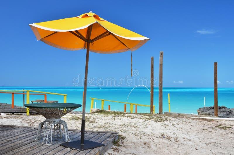 Exuma, Bahamas. Yellow umbrella. Little Exuma, Bahamas stock photography