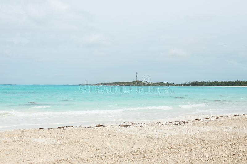 Exuma beach landscape. View of the beach, ocean and distant coastal landscape in Exuma, a district in the Bahamas stock photo