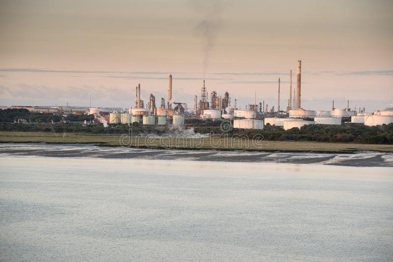 Exxon Fawley refinery on Southampton water. At dawn. Fawley Refinery is an oil refinery located at Fawley, Hampshire, England. The refinery is owned by Esso stock photography