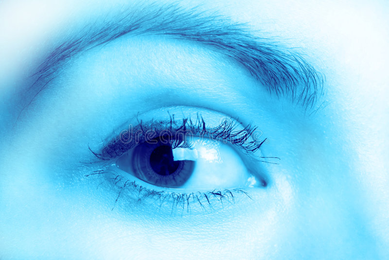 Eye. Female eye, in blue tonality, close up royalty free stock photography