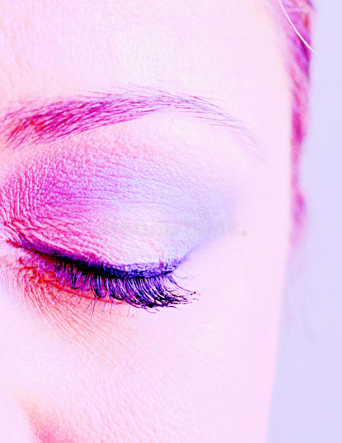 Eye of an attractive young woman closed royalty free stock photography