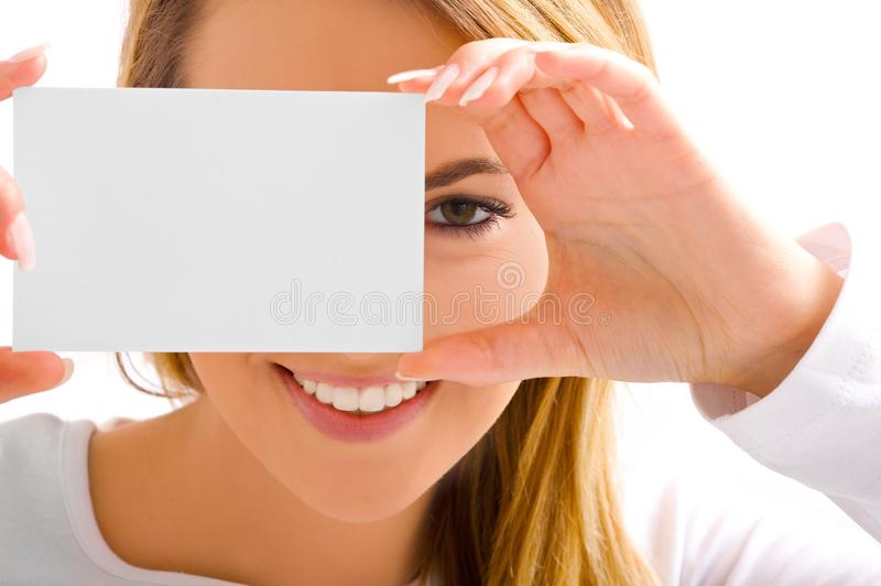 Eye and card. Beautiful blond girl's eye and card