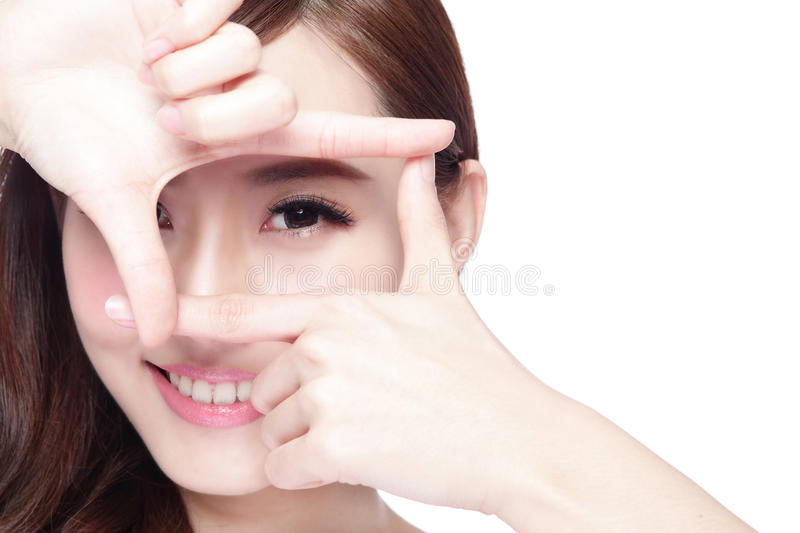 Eye care concept. Woman face and eye care and she making frame with hands, asian woman stock photography