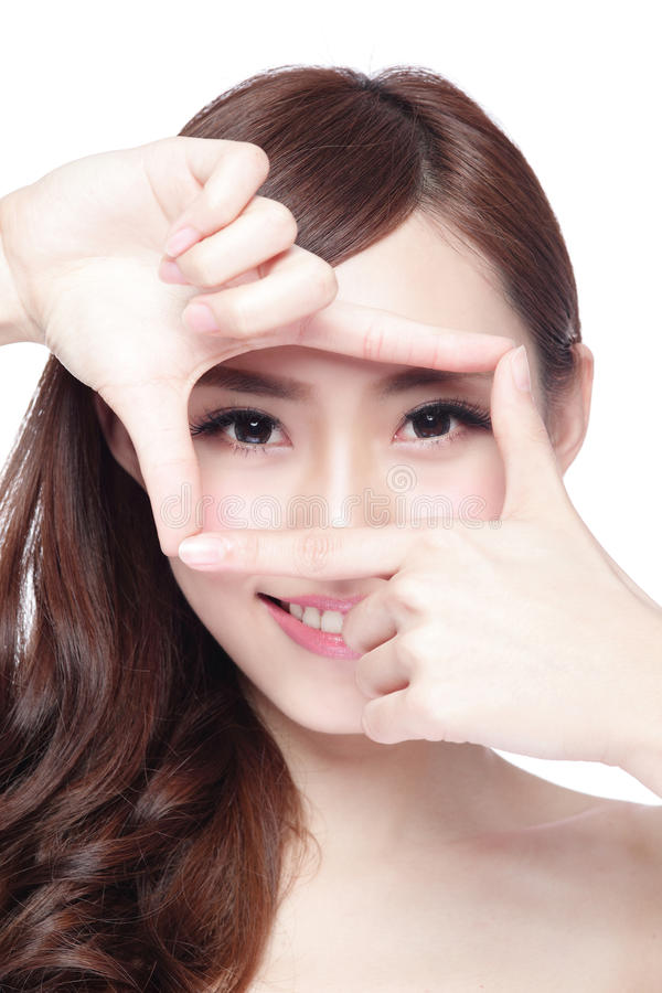 Eye care concept. Woman face and eye care and she making frame with hands, asian woman stock image