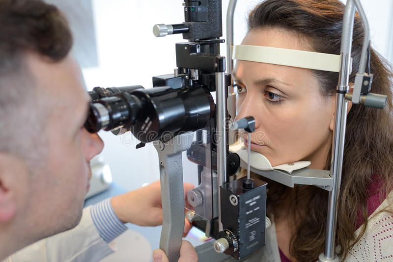 Eye doctor druring test with patient. Eye doctor druring a test with patient royalty free stock image