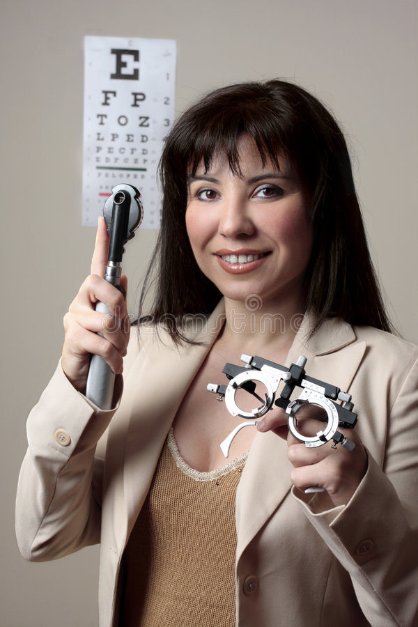Eye doctor with equipment stock photography