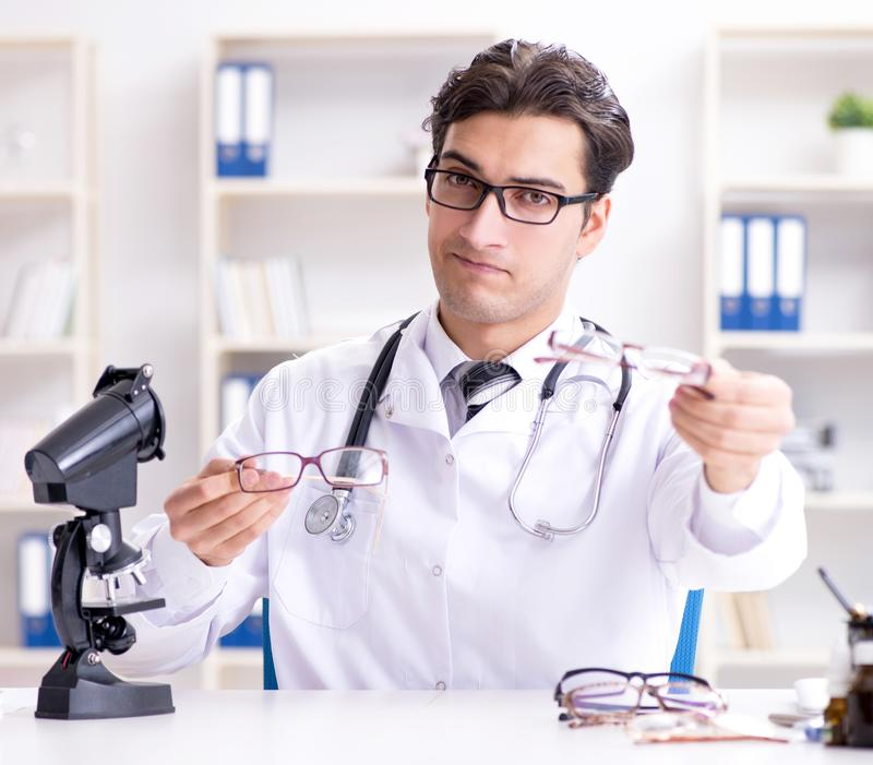 Eye doctor in medical concept stock photo