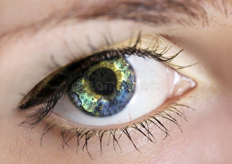 Eye with earth stock photo