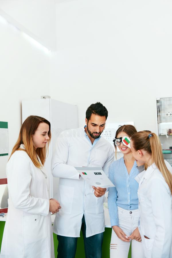 Eye Exam. Doctors Checking Woman Eyesight With Optometry Glasses stock photos