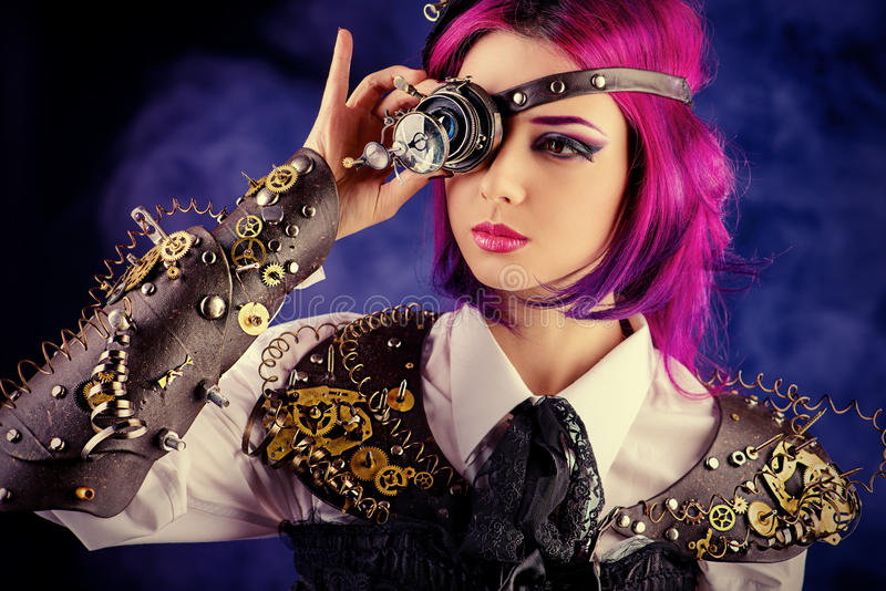 Eye gears. Girl in a stylized steampunk costume posing on a dark background. Anime royalty free illustration