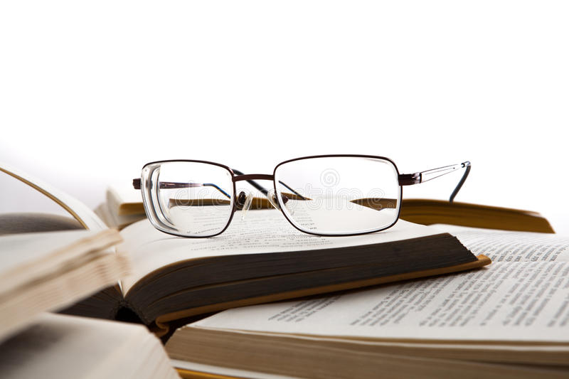 Eye glasses on the books. Isolated on a white royalty free stock photo