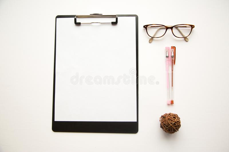 Eye glasses and pens on white background stock photos