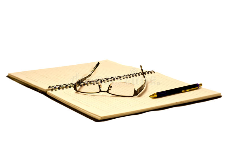 Eye Glasses On Planner Royalty Free Stock Photography
