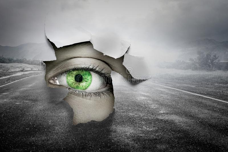 Eye in a hole of torn paper royalty free stock photos