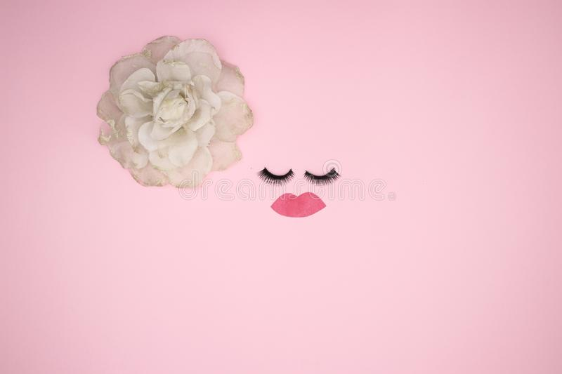 Eye lashes and accessories on the pink background royalty free stock photography