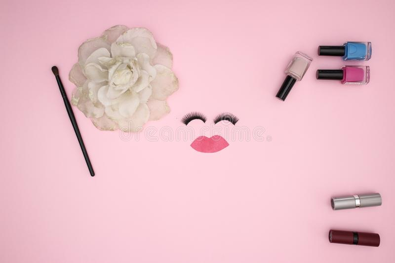 Eye lashes and make up products on the pink background royalty free stock image