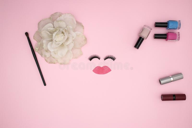 Eye lashes and make up products on the pink background royalty free stock photography