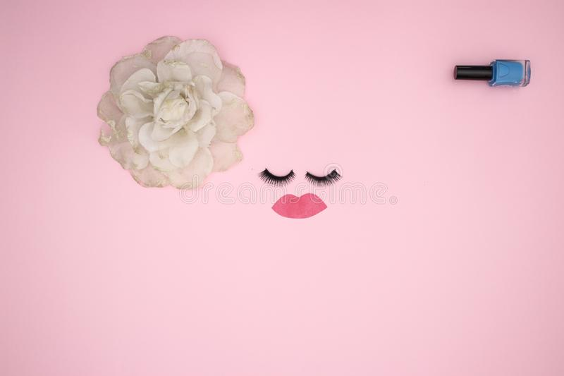 Eye lashes and make up products on the pink background royalty free stock photos