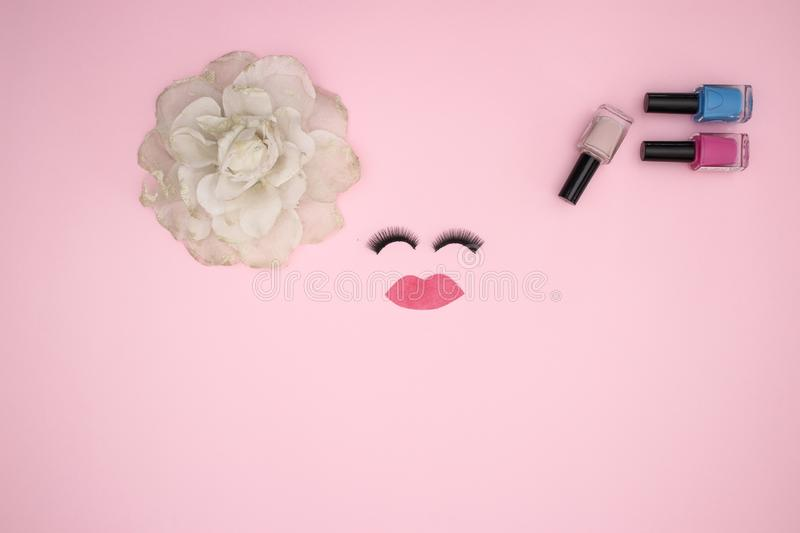 Eye lashes and make up products on the pink background stock image