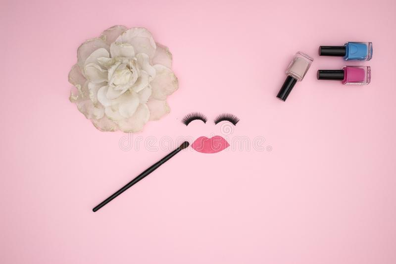 Eye lashes and make up products on the pink background stock photos