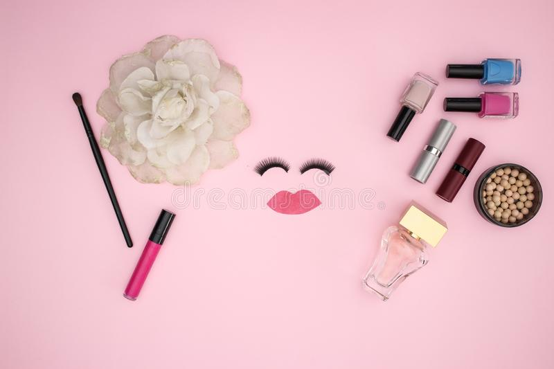 Eye lashes and make up products on the pink background stock images