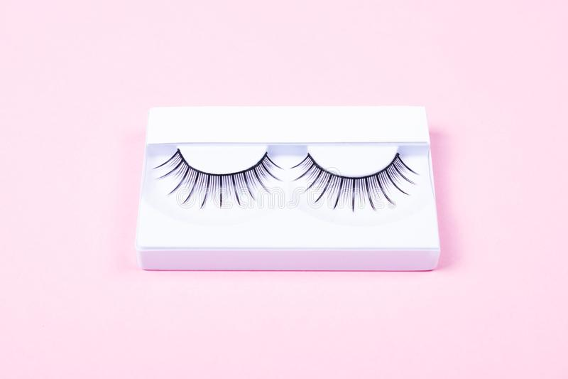 Eye lashes on pink background royalty free stock photo