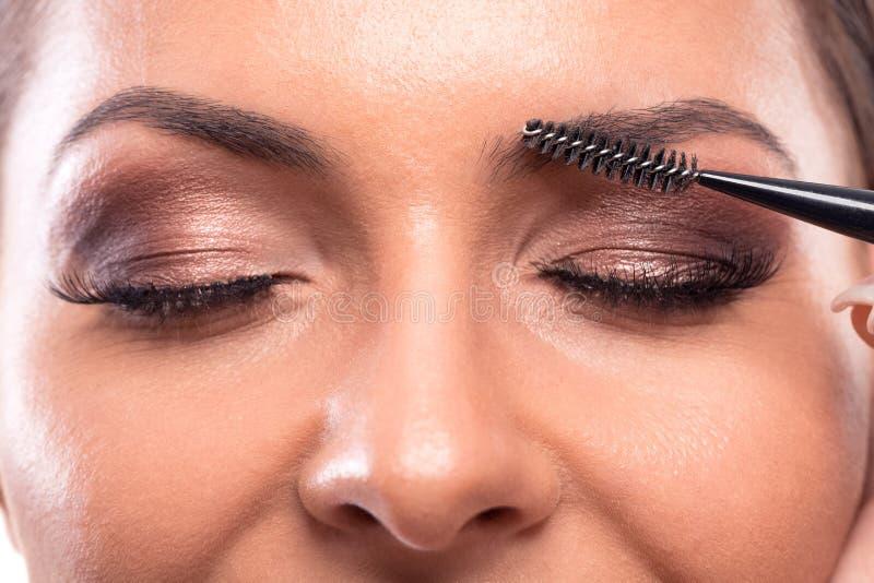 Eye-liner, palpebre, labbra e aree delle sopracciglia fatte con permanente immagini stock