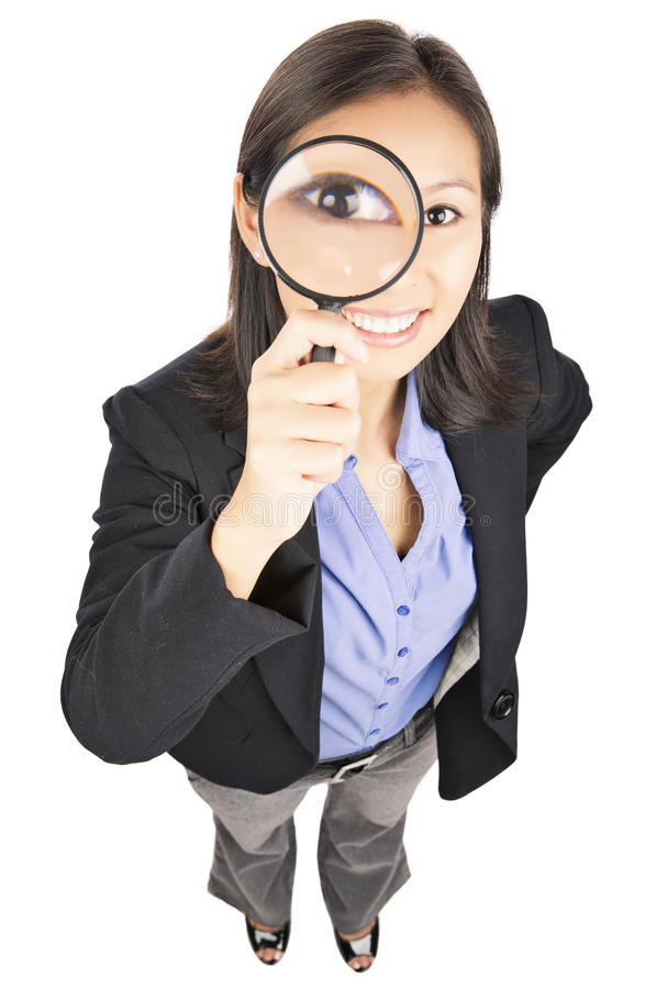 Eye in magnifying glass. Businesswoman portrait of happy young woman holding a magnify glass isolated on white background stock image