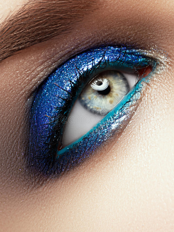 Eye Makeup. Beautiful Eyes Glitter Make-up. Holiday Makeup detail. stock photo