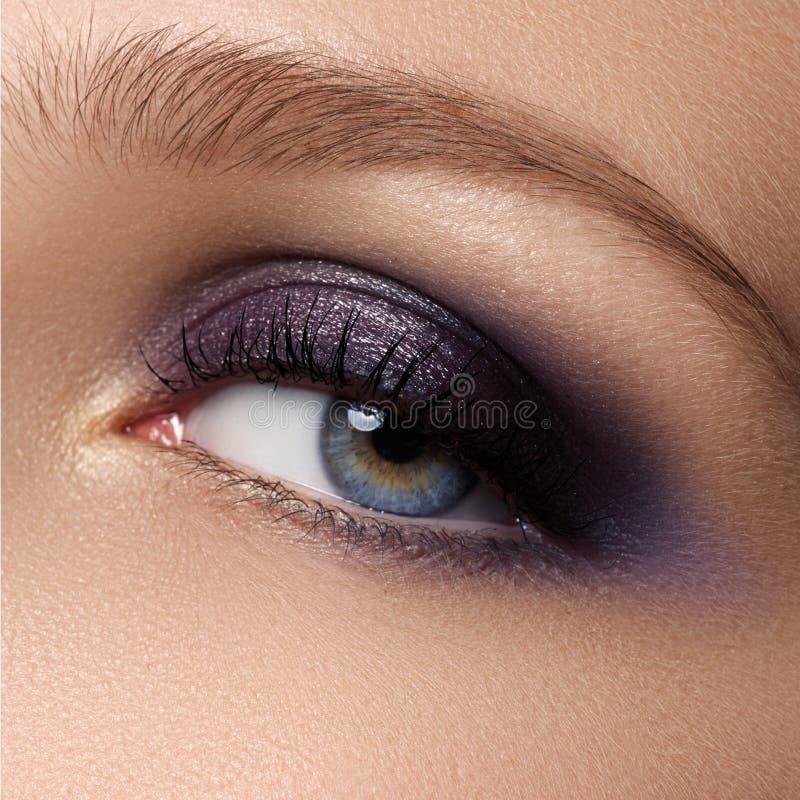 Eye makeup. Beautiful eyes make-up. Holiday makeup detail. Long stock image