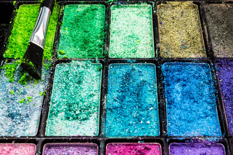 Eye makeup powder colours closeup in palette royalty free stock photography
