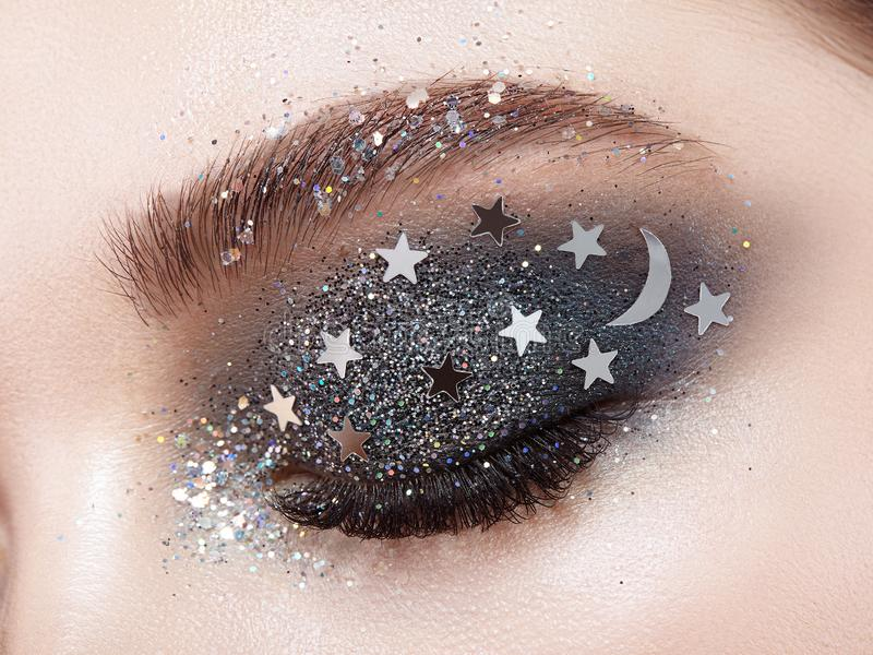 Eye makeup woman with decorative stars. Perfect makeup. Beauty fashion. False Eyelashes. Cosmetic Eyeshadow. Make-up detail. Eyeliner. Creative make-up the stock image