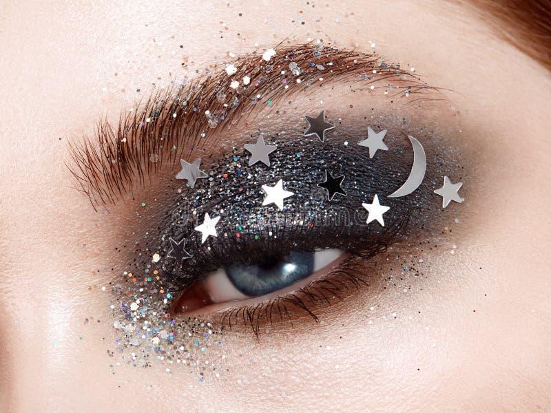 Eye makeup woman with decorative stars. Perfect makeup. Beauty fashion. False Eyelashes. Cosmetic Eyeshadow. Make-up detail. Eyeliner. Creative make-up the stock photos