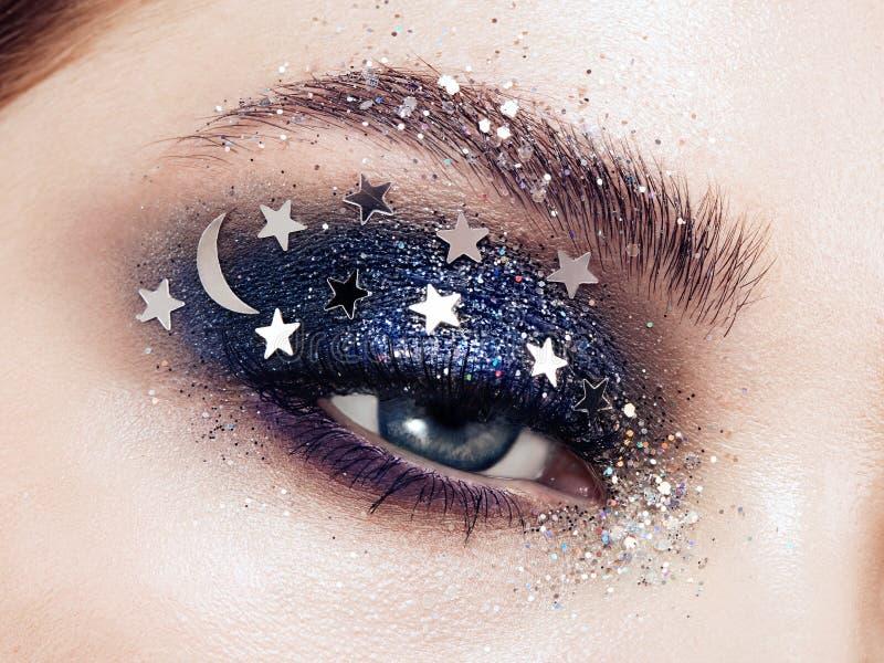Eye makeup woman with decorative stars. Perfect makeup. Beauty fashion. False Eyelashes. Cosmetic Eyeshadow. Make-up detail. Eyeliner. Creative make-up the royalty free stock photo