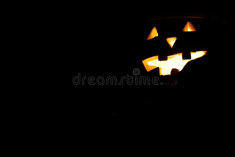Eye and mouth of Halloween pumpkin. The candle light is shining over eye and mouth of Halloween pumpkin royalty free stock photo