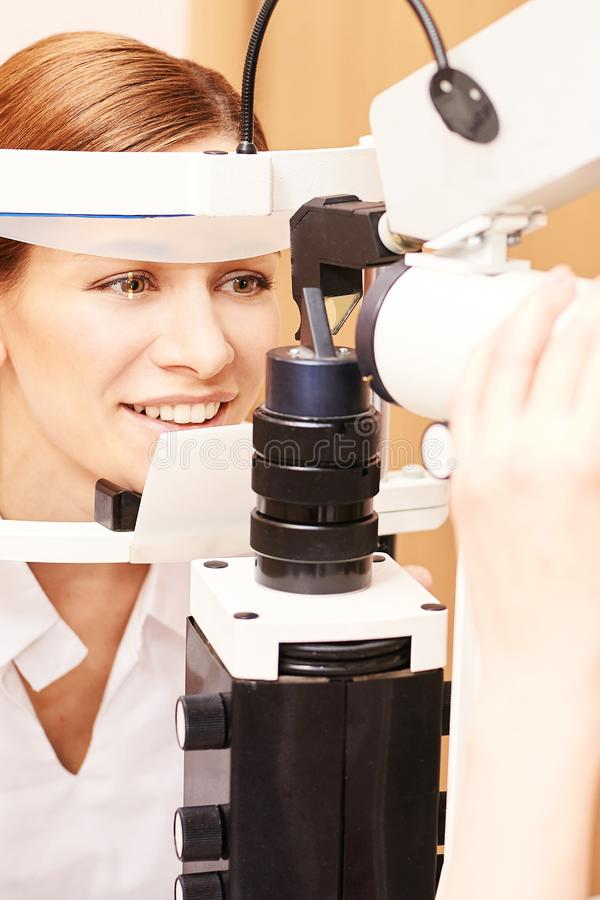 Eye ophthalmologist exam. Eyesight recovery. Astigmatism check concept. Ophthalmology diagmostic device. Beauty girl portrait in royalty free stock photo
