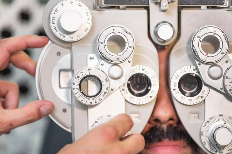 Eye ophthalmologist exam. Eyesight recovery. Astigmatism check concept. Ophthalmology diagnostic device. Eye ophthalmologist exam. Eyesight recovery stock image