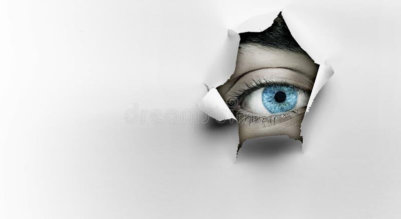Eye peeping through hole. Mixed media stock photos